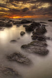 Phuket Sunset. Sunset in Phuket with the misty sea and rocks scattered all around Royalty Free Stock Photography