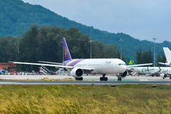 Airplane taxiing on runway of Phuket Airport royalty free stock photos