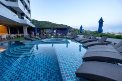Phuket, Thailand - Apr 04 2017 : Hotel swimming pool with sunbeds and bar in hotel. Phuket, Thailand - Apr 04 2017 : Hotel swimming pool with sunbeds and bar in stock images