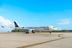 Star alliance airplane of Thai Airways. PHUKET, THAILAND - 24 APR 17: Star Alliance airplane of Thai Airways is arriving in Phuket international airport Stock Photography