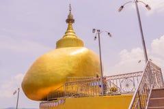 Phuket, Thailand - April 25, 2016 : The replica of Phra That In-Kwaen (Hanging Golden Rock) at Koh Sirey temple, Phuket, Royalty Free Stock Photo