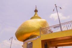Phuket, Thailand - April 25, 2016 : The replica of Phra That In-Kwaen (Hanging Golden Rock) at Koh Sirey temple, Phuket, Royalty Free Stock Image