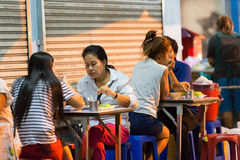 PHUKET, THAILAND - APRIL 26, 2015: Some customers are sitting at the restaurant tables. PHUKET, THAILAND - APRIL 26, 2015: Some customers are sitting at the Royalty Free Stock Images