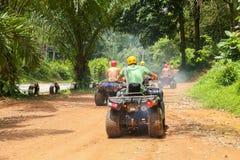 PHUKET, THAILAND - AUGUST 23 : Tourists riding ATV to nature adv Stock Photo