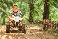 PHUKET, THAILAND - AUGUST 23 : Tourists riding ATV to nature adv Royalty Free Stock Images
