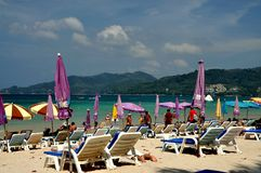 Phuket, Thailand: Chairs and Umbrellas on Patong Beach Royalty Free Stock Photography