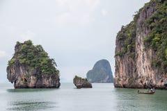 Phuket, Thailand - circa September 2015: Boat sails near limestone cliffs of Andaman Sea, Phang Nga Bay,  Thailand Royalty Free Stock Image
