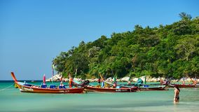 Group of long-tail boats converted boat excursions in order to serve tourists cruising the island. PHUKET , THAILAND,DEC 2017 : Group of Long-tail boats stock video footage
