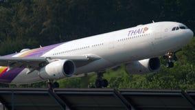 Airbus A330 landing. PHUKET, THAILAND - DECEMBER 1, 2018: Thai Airways Airbus 330 HS-TEN landing, International Phuket Airport stock video footage