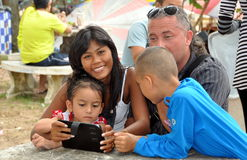 Phuket, Thailand: Family with Electronic Pad Stock Photo