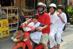 Phuket, Thailand: Family on Motorcycle Royalty Free Stock Images