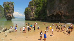 Phuket, Thailand - February 19, 2017: Tourists take a pics in the background famous rocky James Bond Island. stock footage