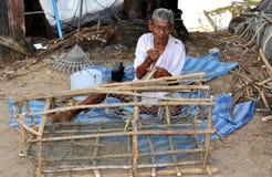 Phuket, Thailand: Fisherman Mending Trap Net Stock Photos
