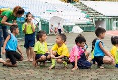 PHUKET, THAILAND - JUL 13 : Schoolchild runners are preparing in Stock Image