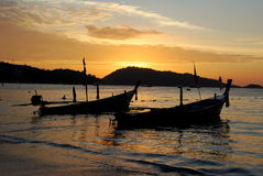 Phuket, Thailand: Longboats on Sea at Sunseyt Stock Images