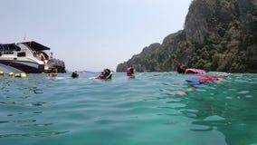 Phuket, Thailand - March 28, 2018 : Asian tourist swimmers enjoying near the reef at Phuket.  stock footage