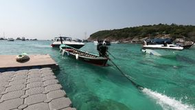 Phuket, Thailand - March 27, 2018 : Long tail boat at Patok Bay, Koh Racha Yai Island.  stock video