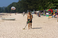 PHUKET, THAILAND - MARCH 25, 2016:Treasure hunter with Metal detector on the beach. A treasure hunter with Metal detector on the beach Royalty Free Stock Photo