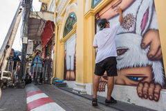 Phuket, Thailand - May 9, 2016: Artist Alex Face removing his mu Stock Photos