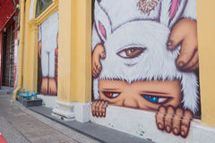 Phuket, Thailand - May 7, 2016: A mural artwork of an iconic character 'Mardi', a kid in a bunny outfit by Alex Face Stock Photos