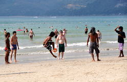 Phuket, Thailand: Men Playing Soccer on Beach Royalty Free Stock Photo