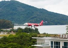 Airbus AirAsia lands. PHUKET, THAILAND - NOVEMBER 29, 2016: Airbus A320-216, HS-BBS of AirAsia is landing and approach from the sea at Phuket International stock images