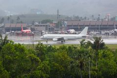 Airbus AirAsia lands. PHUKET, THAILAND - NOVEMBER 29, 2016: Airbus A320-216, 9M-AFO of AirAsia is landing at Phuket International Airport stock images