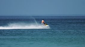 Man on a jet ski in the ocean stock video footage