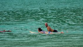 Surfers on the waves stock footage