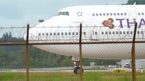 Thai Airways Jumbo turn runway. PHUKET, THAILAND - NOVEMBER 26, 2017: Thai Airways Boeing 747 HS-TGB taxiing to the start on the Phuket airport. Mai Khao beach stock video footage