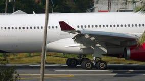 Airbus A330 landing. PHUKET, THAILAND - NOVEMBER 29, 2018: Thai Lion Airbus A330 braking after landing, International Phuket Airport stock footage