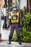 Thai policman during a street procession in Vegetarian Festival at Phuket Town, Thailand Royalty Free Stock Image