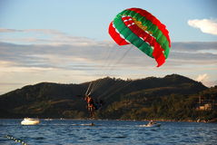 Phuket, Thailand: Paragliding Over the Sea Stock Photos