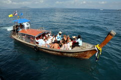 Phuket, Thailand: Tourists on a Longboat Stock Photography