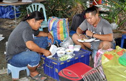 Phuket, Thailand: Two Men Eating Dinner Stock Photo