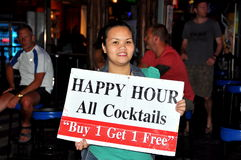 Phuket, Thailand: Woman with Happy Hour Sign Royalty Free Stock Photo