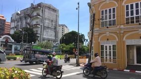 Phuket Town - 21 November: crossroad traffic ligth in old town. Old Thailand architecture stock footage