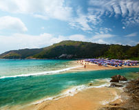 Phuket. Tropical beach with a lot of umbrellas. Nai Harn beach, Phuket, Thailand Stock Photography