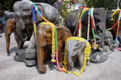 Phuket wooden elephants sculptures decorated with garlands Royalty Free Stock Images