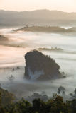 Phulangka mountain with mist and sunrise in Payao Province, thai. Phulangka mountain with mist and sunrise in Phu Langka National Park in Payao Province Royalty Free Stock Photo