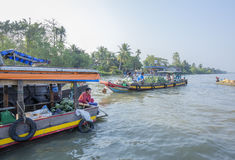 Phung Hiep floating market at seven-ways crossroads (Nga Bay), Can Tho city, Tien Giang Royalty Free Stock Photography