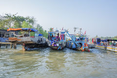 Phung Hiep floating market at seven-ways crossroads (Nga Bay), Can Tho city, Tien Giang. Local boats at ferry, Phung Hiep floating market, 7-ways crossroads Nga Royalty Free Stock Images