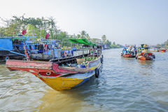 Phung Hiep floating market at seven-ways crossroads (Nga Bay), Can Tho city, Tien Giang Royalty Free Stock Photo