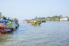 Phung Hiep floating market at seven-ways crossroads (Nga Bay), Can Tho city, Tien Giang. Local fruit and flower boat, Phung Hiep floating market, 7-ways Royalty Free Stock Image