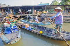 Phung Hiep floating market at seven-ways crossroads (Nga Bay), Can Tho city, Tien Giang Stock Images