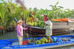 Phung Hiep floating market at seven-ways crossroads (Nga Bay), Hau Giang. People bring their fruit in their garden to Phung Hiep floating market in the morning Stock Photography