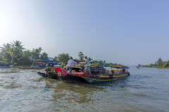 Phung Hiep floating market at seven-ways crossroads (Nga Bay), Hau Giang. A view of local fruit boats on the river, Phung Hiep floating market in the morning, 7 Royalty Free Stock Images