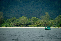 Phuo Quoc fishingboat. A boat in front of the jungle of Phuo Quoc, Vietnam Stock Images