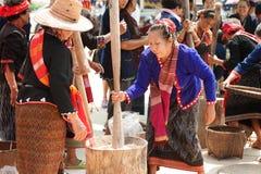 Phutai minority woman pounding rice. KALASIN,THAILAND-MARCH 9 : Unidentified Phutai minority senior woman competitive pounding rice fun and happiness in The 2nd Stock Photos