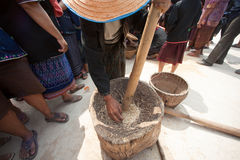 Phutai minority woman pounding rice. KALASIN,THAILAND-MARCH 9 : Unidentified Phutai minority senior woman competitive pounding rice fun and happiness in The 2nd Royalty Free Stock Photo